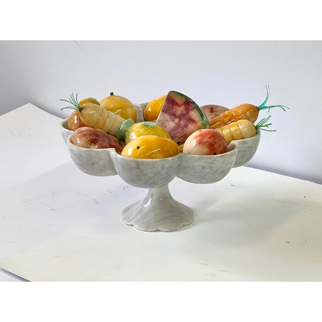 Italian 20th Century beautifully scalloped tazza in gray and white marble. The tazza is holding a set of colorful fruits...