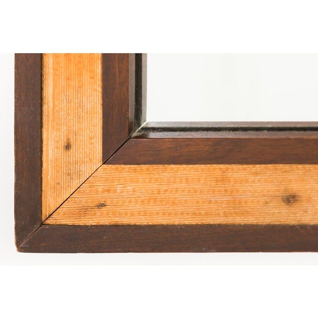 A 4799 square mirror with double frame designed by Edward Wormley for Dunbar in USA, c 1950s. This piece is mahogany....