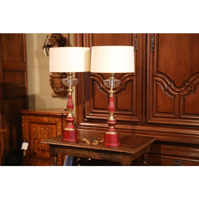 """Elegant pair of antique oil lamps made into table fixtures from Paris, France; crafted circa 1870, the tall """"lampes a..."""