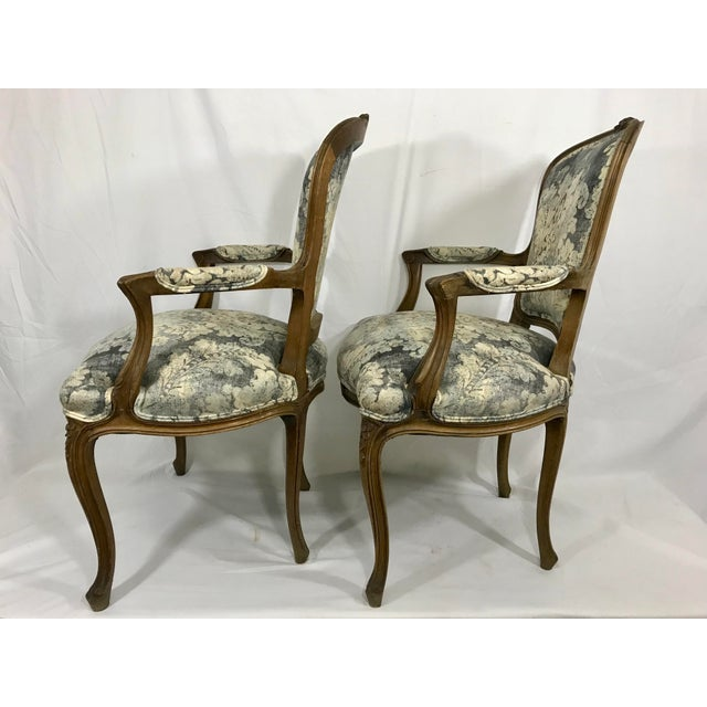Who can't use another pair of chairs for occasional seating? This charming little pair of Louis XV style walnut arm chairs...