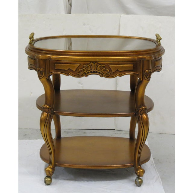 French / Italian / European style giltwood rolling cart. It features carved detail on all sides, cabriole legs and a...