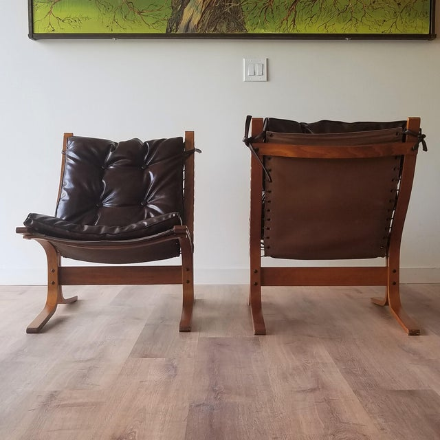 Pair of newly upholstered 1970s Ingmar Relling's 'Siesta' Chairs for Westnofa Furniture as well as one ottoman. The teak...