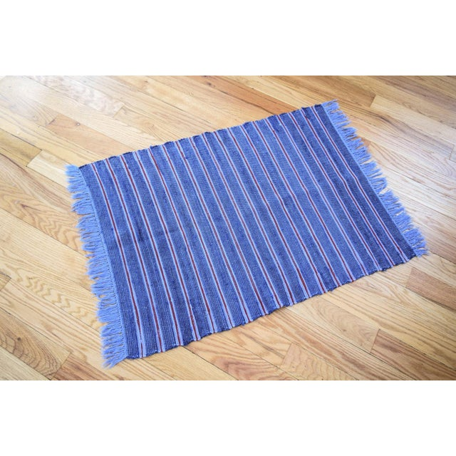 • Vintage Swedish style hand loomed woven rag rug. • Vibrant navy blue and indigo with thin red stripes. • Wonderful...