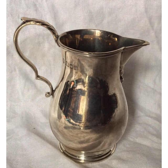 Great quality Sterling silver pitcher with English hallmarks.