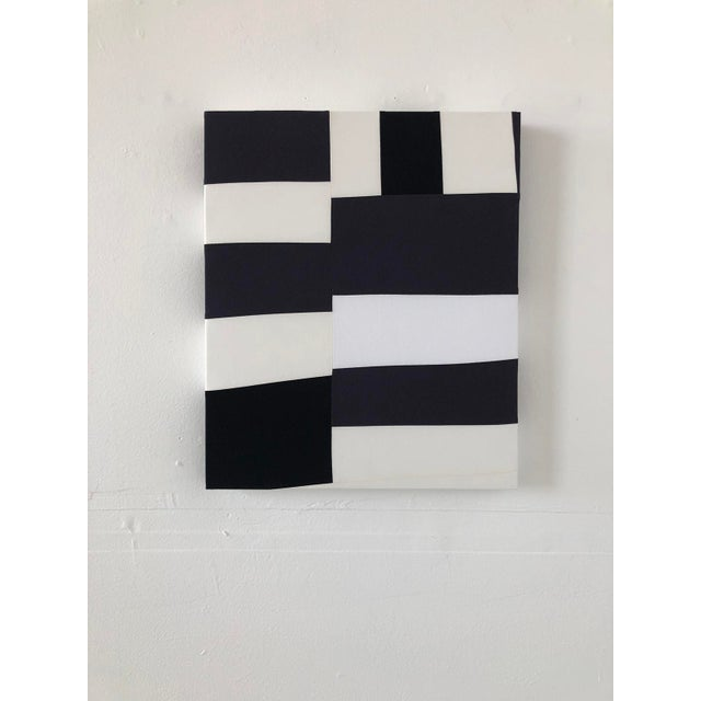 Abstract minimalist textile painting in black and white by artist Heather Jones. Pieced improvisational patchwork in...