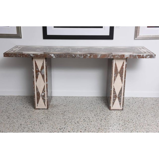 The main body of this console table is composed of red-variegated marble with inset ivory marble veneers on a wood-form....