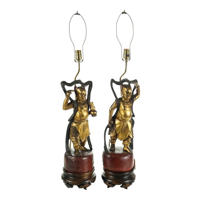 Chinese Carved Gilt Wood Figural Lamps - A Pair For Sale