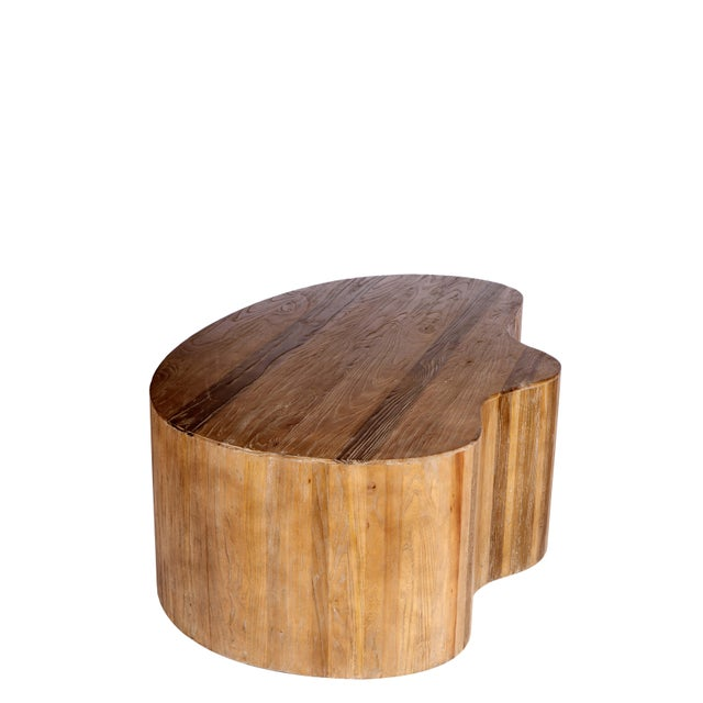 New elm wood coffee table with free form. Use it with Portia table to complete the look. NO CUSTOM ORDERS. Sold as it is.