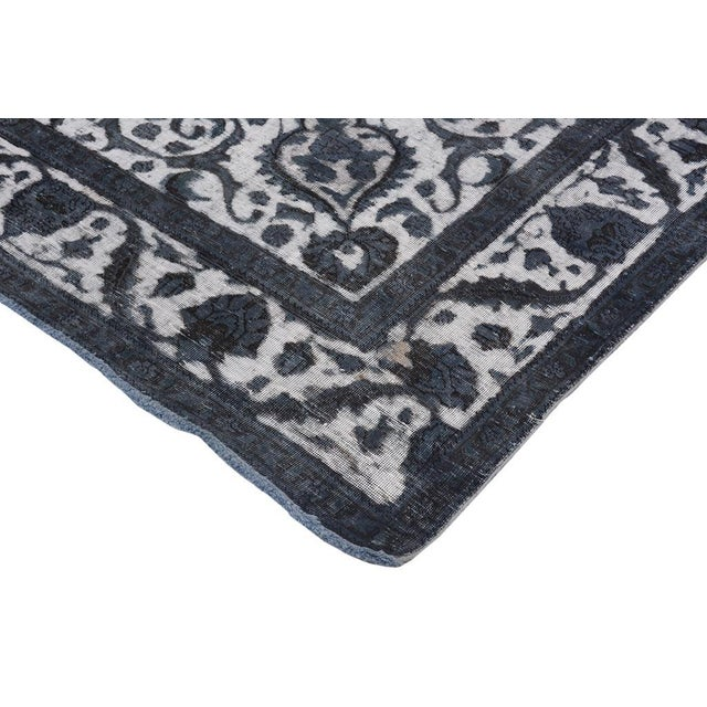 This sublime vintage rug has been hand knotted by master weavers to give it a perfect distressed vintage look and designed...
