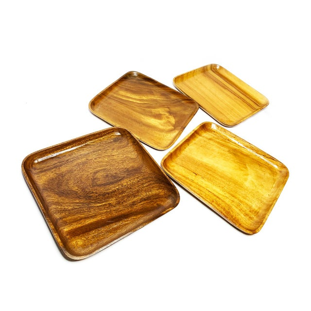Vintage set of 4 large mid-century modern wood plates. This beautiful set includes four square plates with rounded corners...