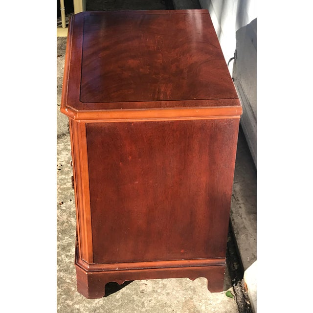 Beautiful Drexel Heritage chippendale nightstand. Features a rich cherry color with brass hardware. A small drawer and two...