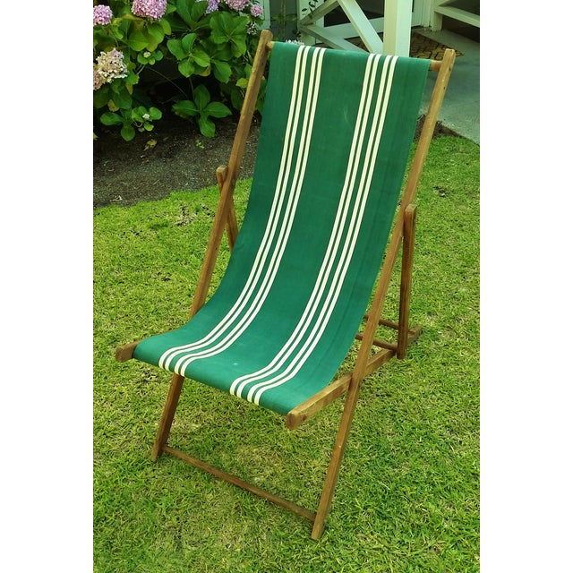 Authentic vintage folding Brighton Beach wooden deck / beach chair with a bold green-and-cream-striped heavy weight cotton...