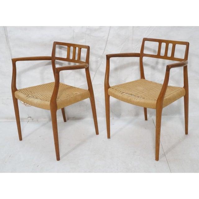 Pair of rare sculptural teak arm chairs designed by Niels O. Møller for his J.L. Møller Møbelfabrik in 1966. Model 64...