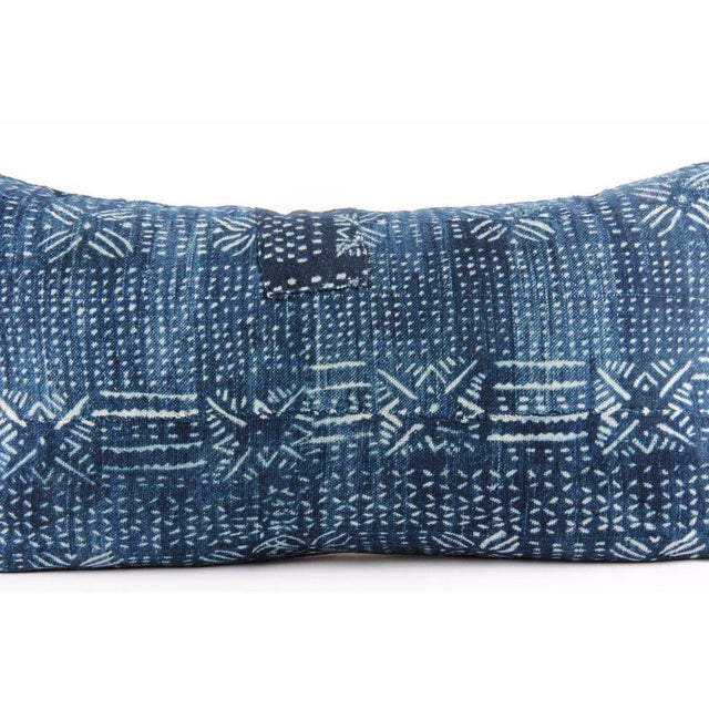 Hand crafted throw pillowcase featuring a vintage, indigo blue African mud cloth textile with an abstract white pattern....