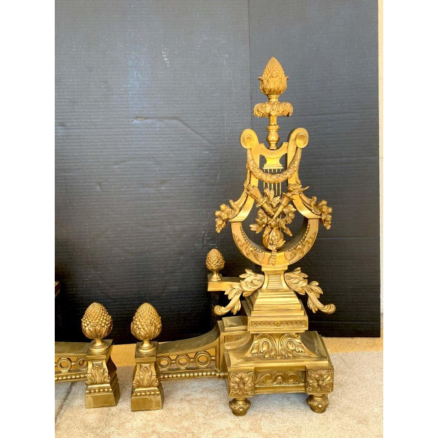Gorgeous pair of Louis XVI style gilt bronze lyre motif chenets, large scale, each one finely cast Lyre surmounted with...