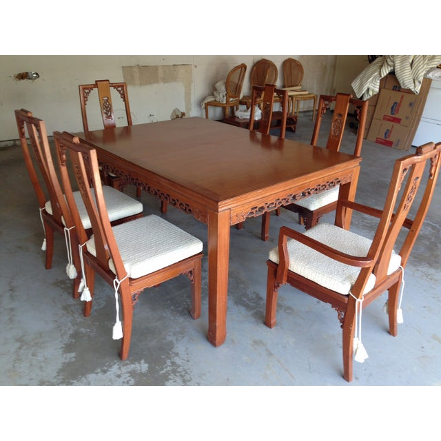 Carved teak dining set with 2 armchairs and 4 dining chairs. Table expands with two matching leaves. Chairs have white...