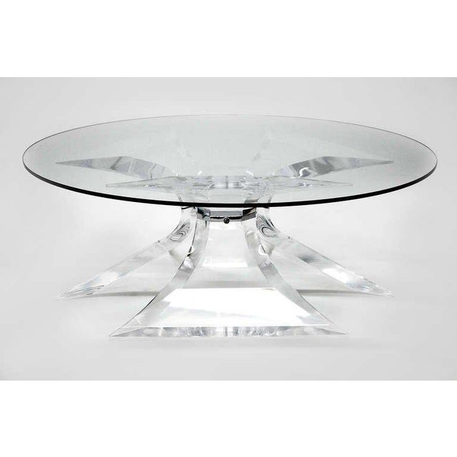 Lion in Frost Lucite coffee table with chrome center. This is only the base, no glass top. Will hold round, square or...