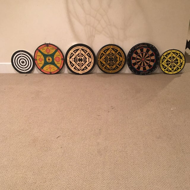 Six unique dartboards. 2 are smaller in size. One is one sided. 5 are double sided.