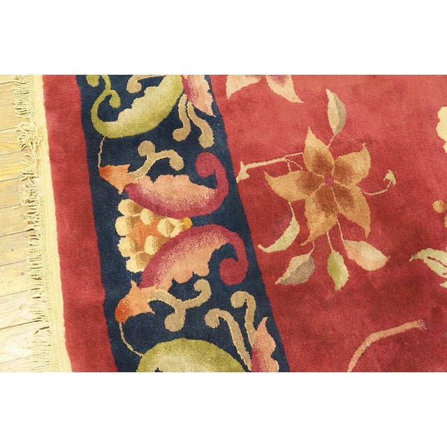 Antique Chinese Art Deco Rug with a red background and navy border.