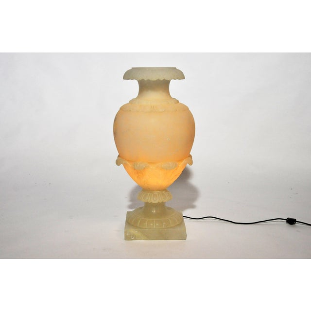 This alabaster jar lamp is from Paris, France, c. 1930. The lamp comes in two parts and has been rewired for use in the...