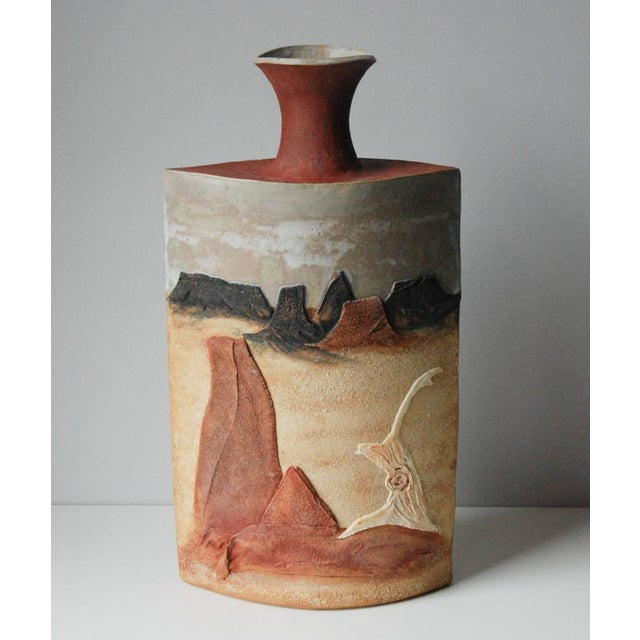 A monumental R. Miller slab built stoneware vase depicting desert sands, plateaus and a sun drenched tree base in relief...