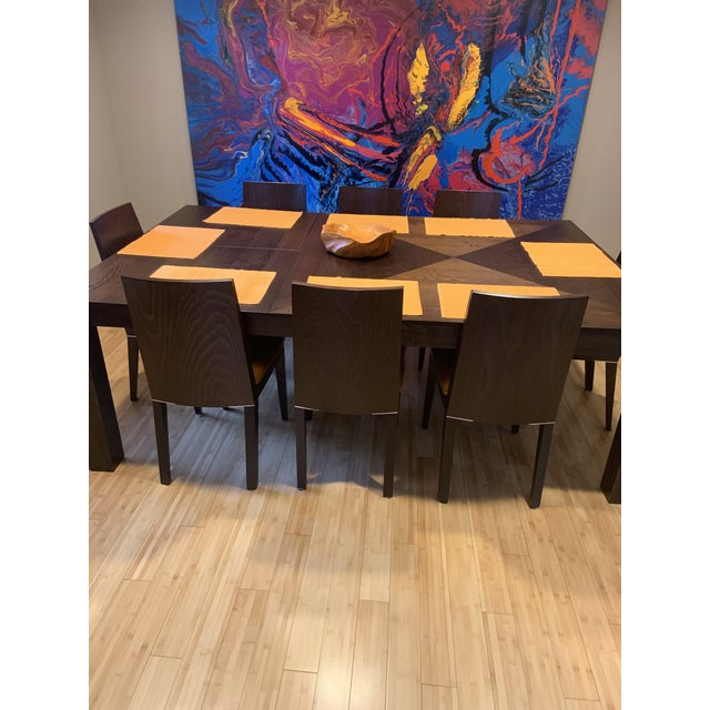 "Italian dining room set. Table is 55""x55"" expandable to 55""x85"" 8 chairs with orange leather seats, the Brennan table from..."