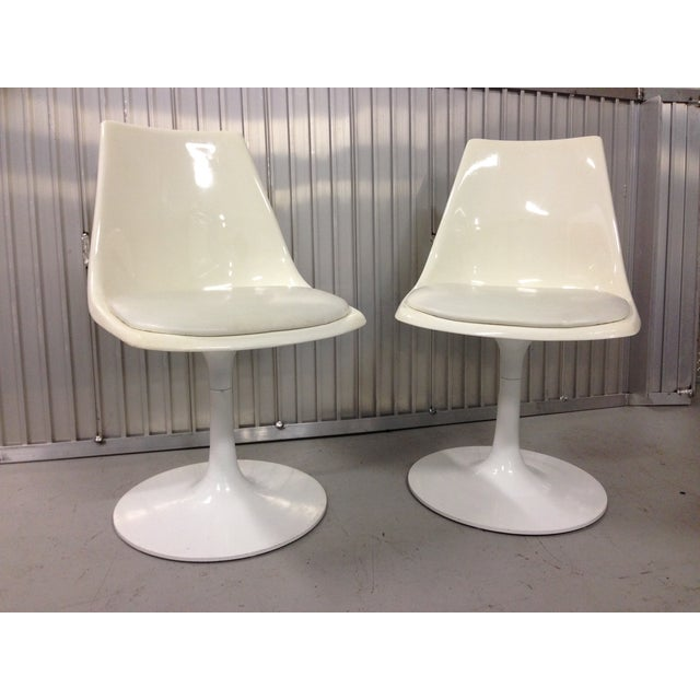 Pair of Vintage Mid Century Modern Fiberglass Tulip swivel chairs with white aluminum base. The bottom of each chair is...