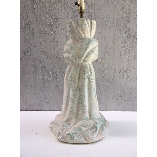 Beautiful plaster lamp with a faux draped fabric look. There is an applied patina.