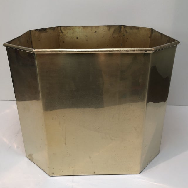 A large solid brass octagon shaped planter or basket. May be used for a small tree, large plant, or to store blankets and...