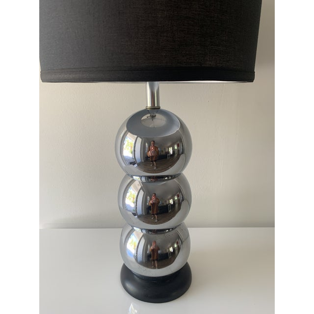 Mid-Century Modern stacking chrome three ball lamp and black wood base in the style of George Kovaks. We have added a...