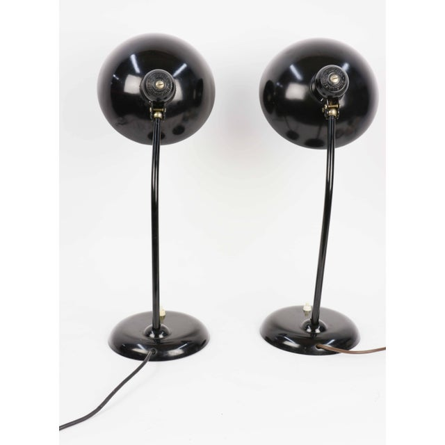 """A handsome pair of Christian Dell for Kaiser """"Ideal 6556"""" table lamp, circa 1930 in jet black."""