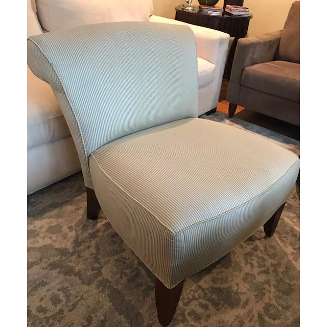 This is a beautiful, clean-lined slipper chair. Elegant or casual, the subtle strip gives it a nice appearance. Usual...