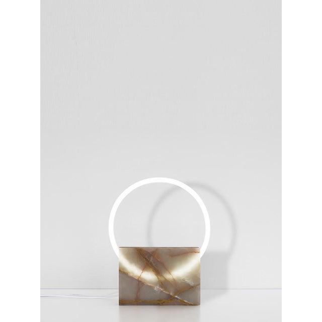 Onyx table lamp - Sabine Marcelis Dimensions: - marble : 160 x 200 x 35mm - neon : Ø250mm Material: Onyx. Sabine Marcelis...