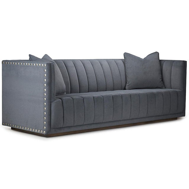 The John Marie sofa is elegant and enticing, this panel-tufted sofa is bolstered to a tuxedo-style hardwood frame with...