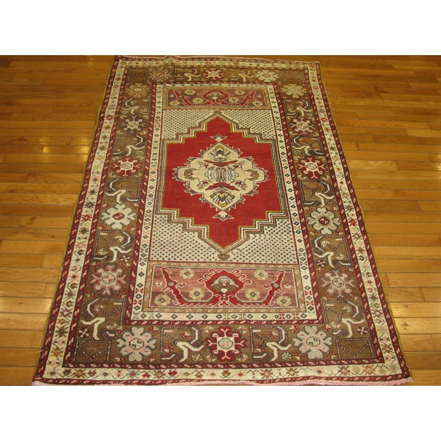 """This is a beautiful, handmade, vintage Turkish rug. It is made with wool and cotton and measures 3' 6'' x 5' 9."""" It is in..."""