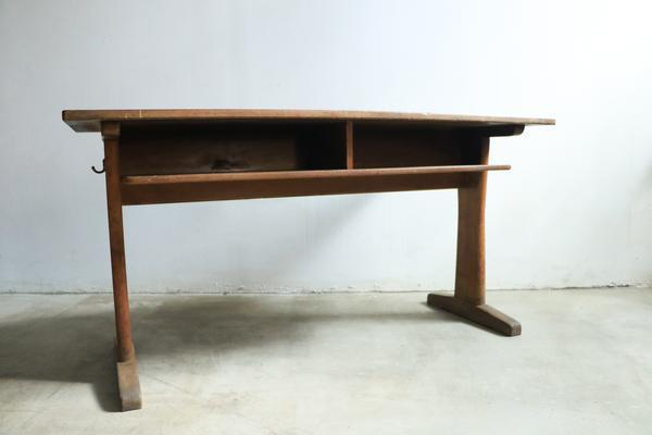 Gentil A Mid Century Modern Worktable Made Of Wood With Pedestal Legs.