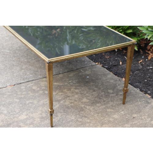 Fabulous brass coffee table from France in Maison Janson style, features smoked glass top