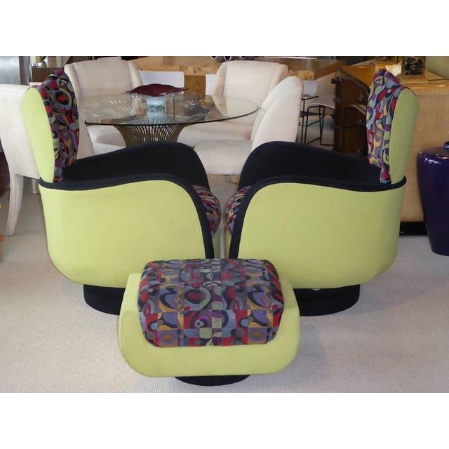 Exceptional Kagan design for Directional, this pair of stylized wingback lounge chairs with an ottoman both swivel and...