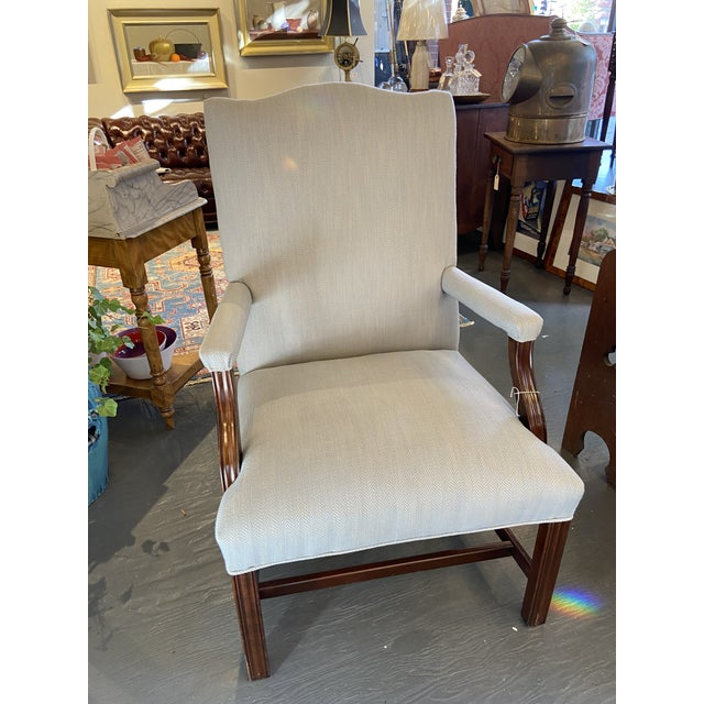 This is a beautiful newly reupholstered mahogany lolling chair. This traditional-style chair has a gorgeous blue designer...
