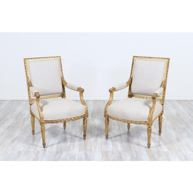 Gorgeous, 1920s French Louis XVI-style giltwood fauteuils with delicately carved decorations and new linen canvas...