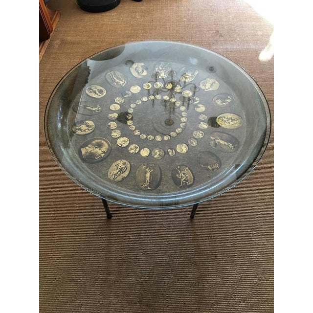 This Fornasetti table depicts Roman motif's in a circular pattern - the table is easy to move and perfect as a side table...