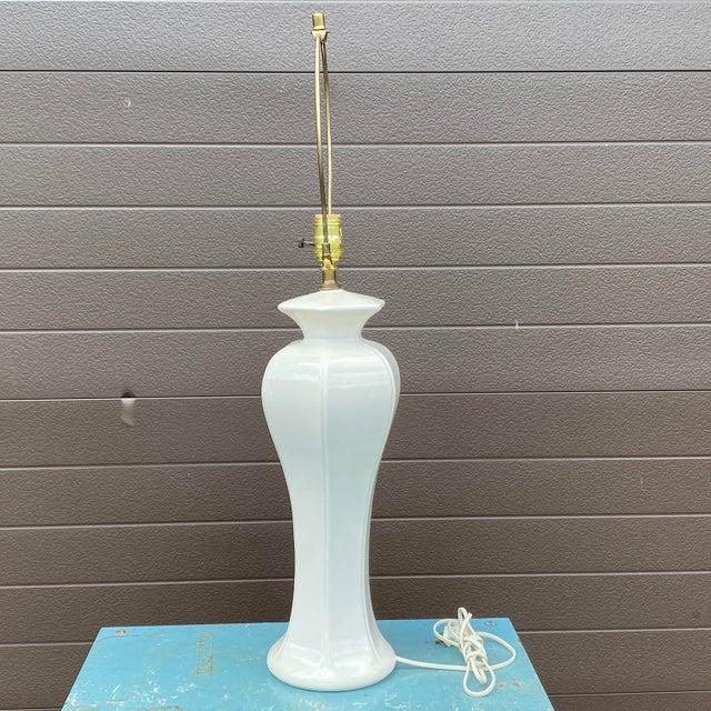 We love the slender form of this solid white ceramic lamp. Original Morris Greenspan label intact.