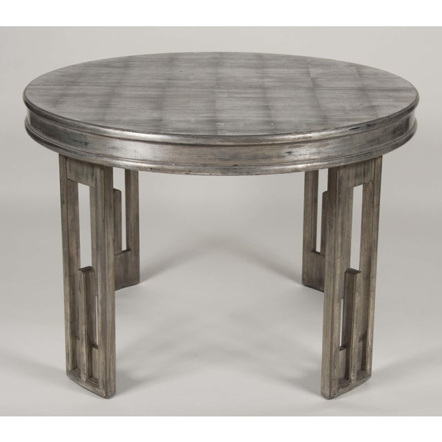 """A Mid-century silver leaf over wood dining table by James Mont. Includes two leaves measuring 12"""" each. Measures: 42""""..."""