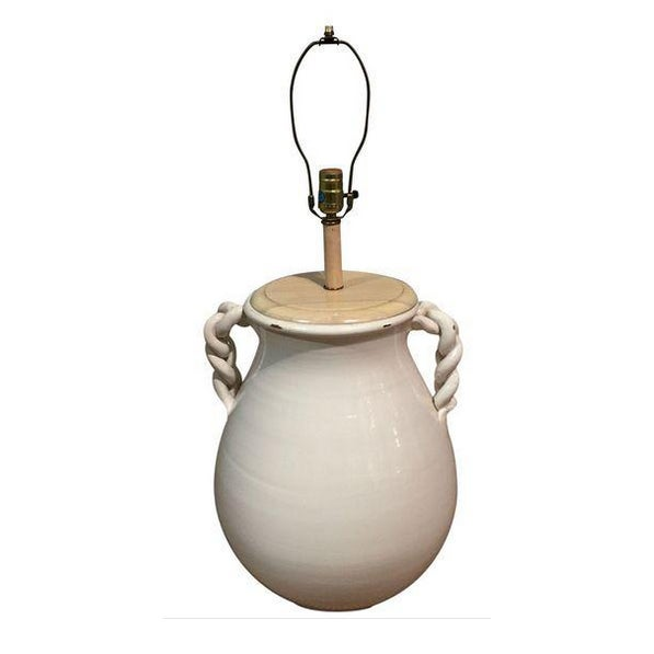Large and dramatic, this mid-century glazed pottery lamp, in a light white/cream color, makes a major statement. Braided...