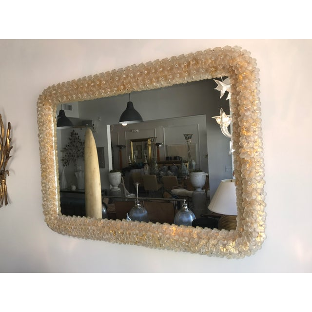 This is a beautiful Murano mirror with several tiny little daisy like flowers applied on a gold leaf frame. This is truly...