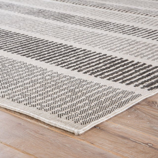 Graphic and geometric, this indoor/outdoor area rug lends clean-lined, modern style to patios and high-traffic living...