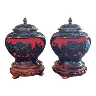 20c Pair of Chinese Cinnabar and Enamel Lidded Urns on Stand