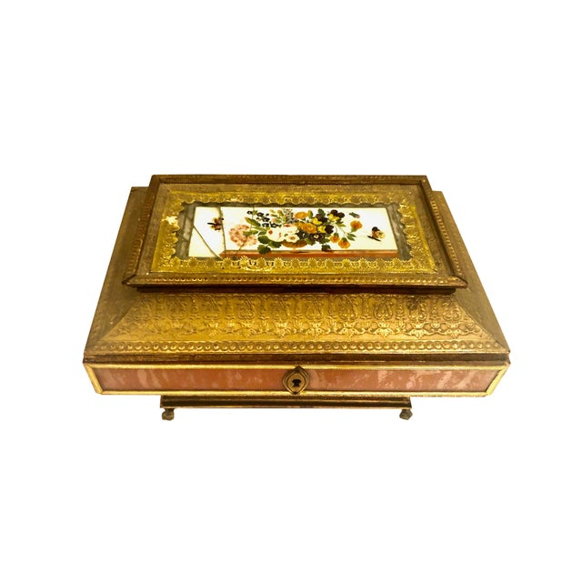 A very early 19th century paper embossed box in the neoclassical style. The box has multiple compartments, it is a work...