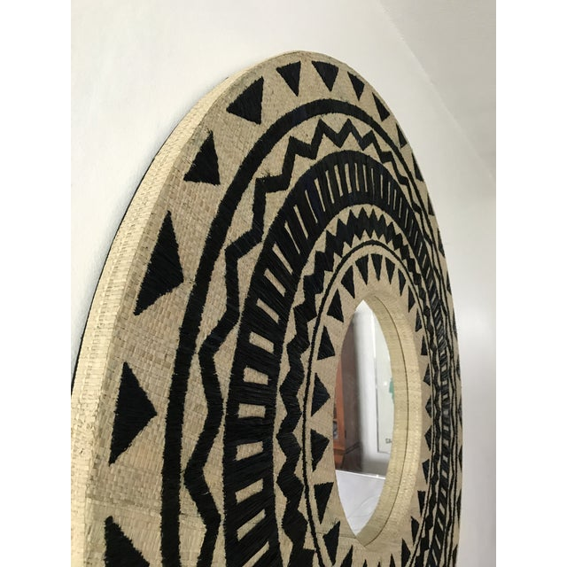 Gorgeous round grasscloth mirror with ethnic embroidery. Made in India