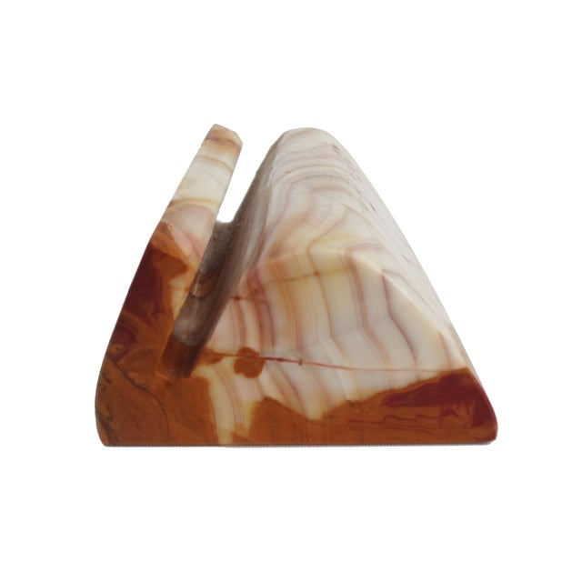 Solid Onyx marble business card holder in cream and caramel tones. Doubles as a paperweight- heavy and substantial.